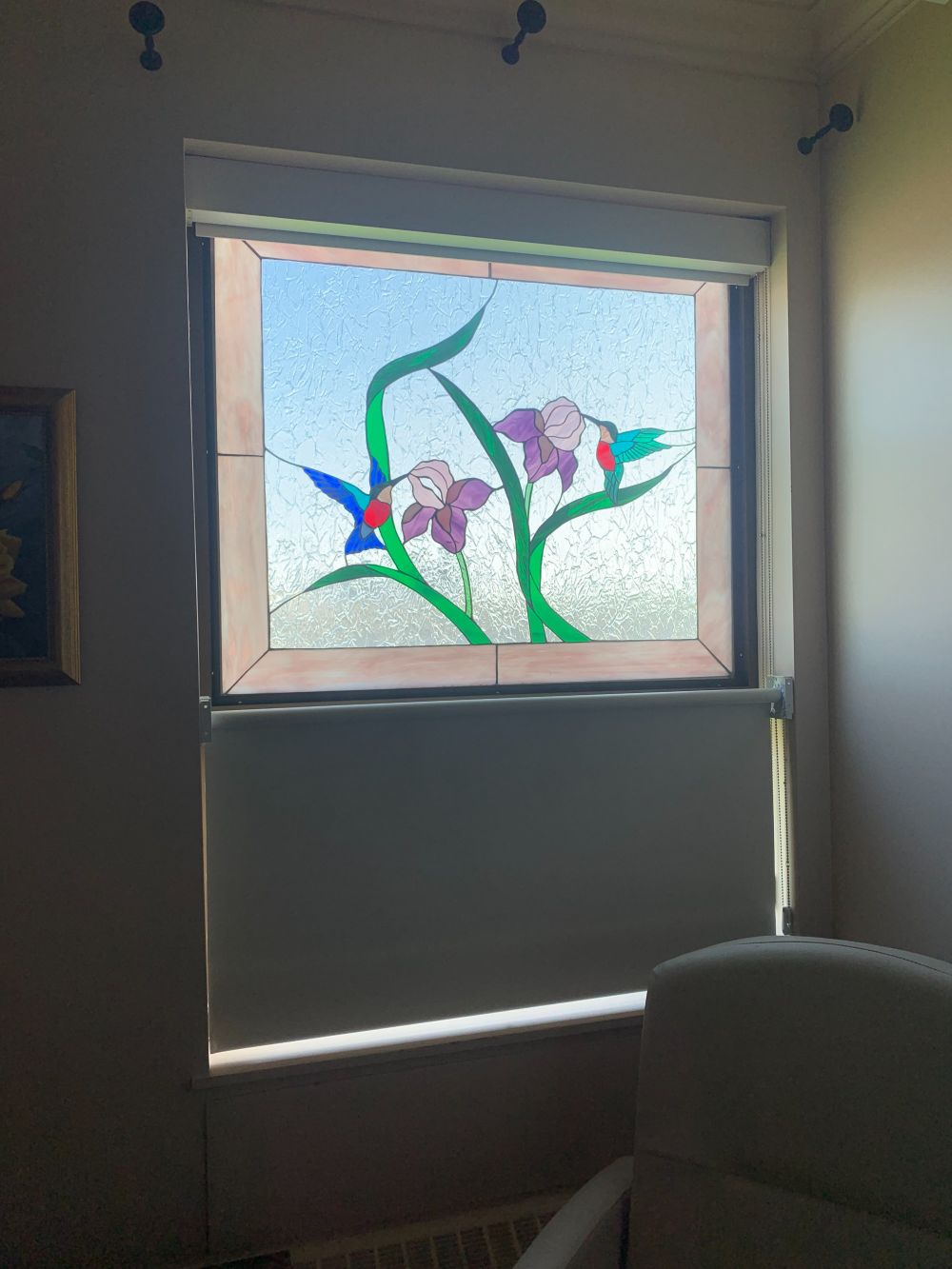 Flowers and hummingbirds in stained glass, window in Palliative Care Unit, Rocky Hospital
